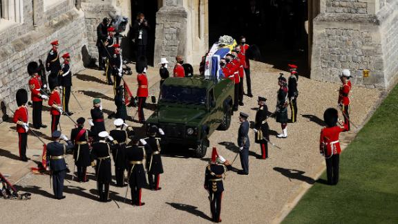 WINDSOR, ENGLAND - APRIL 17: The Duke of Edinburgh's coffin, covered with His Royal Highness's Personal Standard is carried to the purpose built Land Rover during the funeral of Prince Philip, Duke of Edinburgh at Windsor Castle on April 17, 2021 in Windsor, England. Prince Philip of Greece and Denmark was born 10 June 1921, in Greece. He served in the British Royal Navy and fought in WWII. He married the then Princess Elizabeth on 20 November 1947 and was created Duke of Edinburgh, Earl of Merioneth, and Baron Greenwich by King VI. He served as Prince Consort to Queen Elizabeth II until his death on April 9 2021, months short of his 100th birthday. His funeral takes place today at Windsor Castle with only 30 guests invited due to Coronavirus pandemic restrictions. (Photo by Adrian Dennis/WPA Pool/Getty Images)