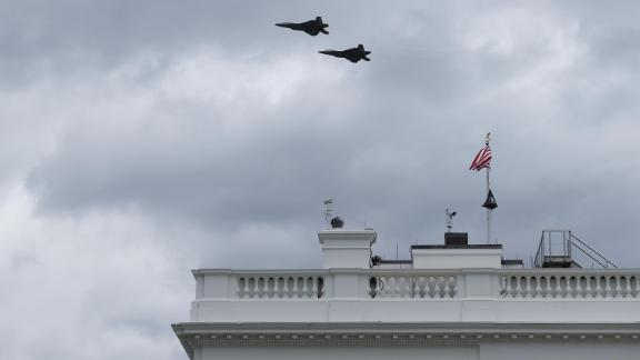 Two military aircraft fly over the White House on April 16, 2021 in Washington, DC. The US Air Force F-22 fighter aircraft flew over Washington as part of the World War I memorial dedication ceremony.