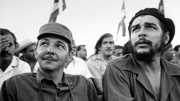 Castro sits next to Cuban revolutionary Che Guevara during a 1964 celebration of the July 26th revolution.