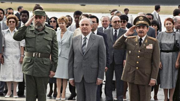 Raul and Fidel Castro stand alongside Soviet Union leader Mikhail Gorbachev as he prepares to leave Cuba after an official visit in 1989.