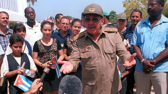 Castro speaks to members of the press during a rally in July 2000 in Manzanillo, Cuba.