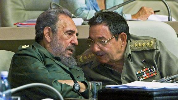 Fidel and Raul Castro confer during a session of the National Assembly in 2001 in Havana.