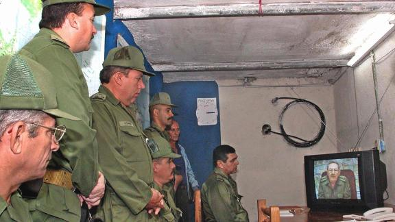 Cuban Army officers watch a message from Castro as he gives the order to begin military exercises conducted by hundreds of thousands of Cuban troops and civilians in Cuba in 2004.