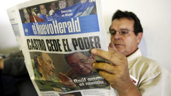 A man in Miami reads the Miami Herald's Spanish-language edition, El Nuevo Herald, with news of Fidel Castro handing over power to Raul Castro in 2006. Castro was undergoing intestinal surgery and provisionally handed over power to his brother.
