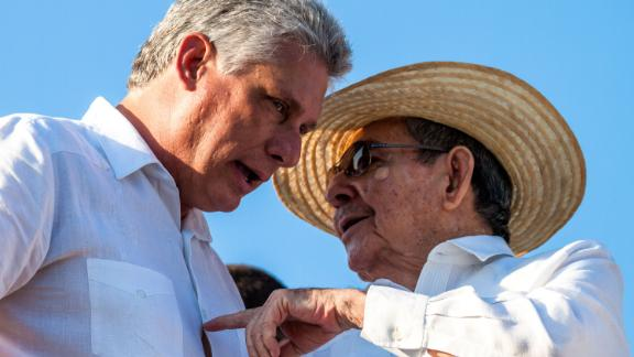 Castro talks with First Vice President of Cuba Miguel Díaz-Canel while watching a May Day parade in Revolution Square in Havana in 2016.
