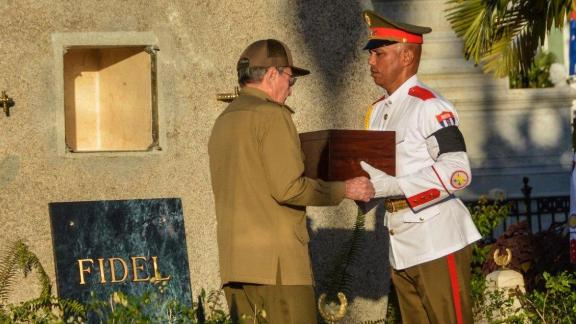 Castro places the urn of his brother Fidel into his tomb at the Santa Ifigenia Cemetery in Santiago de Cuba in 2016.