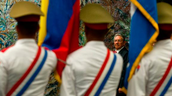 Castro looks at the honor guard before granting Ecuador's President Rafael Correa with the José Martí Order in Havana in 2017.