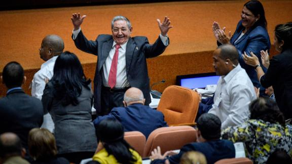 Castro raises his arms in celebration after Miguel Díaz-Canel was elected as the island nation's new president at the National Assembly in Havana in 2018. Castro passed Cuba's presidency to Díaz-Canel, putting the island's government in the hands of someone outside the Castro family for the first time in nearly six decades.
