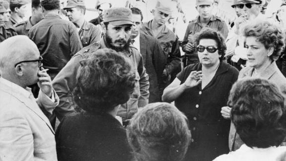 Cuban prime minister Fidel Castro talking with parents of some of the American prisoners held hostage for food and supplies by the Cuban government after the abortive emigre invasion at the Bay of Pigs, January 1963.