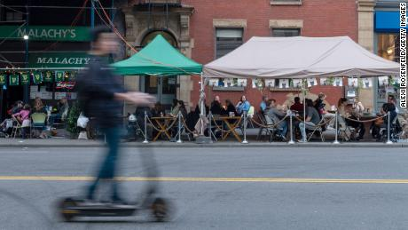 Customers dine at Malachy's outdoor sidewalk tables April 10 in New York City.