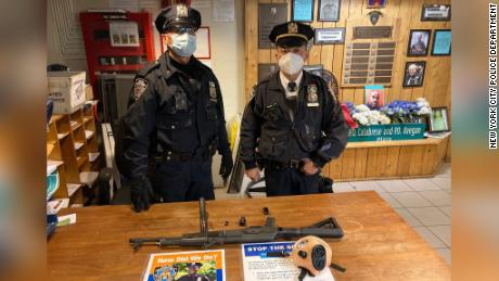 New York police say they confiscated an AK-47 from a teen at a Times Square subway station.