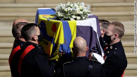 WINDSOR, ENGLAND - APRIL 17: Prince Philip, Duke of Edinburgh's coffin covered with His Royal Highness's Personal Standard is carried by a Bearer Party found by the Royal Marines on the West Steps of Windsor Castle during the funeral of Prince Philip, Duke of Edinburgh at Windsor Castle on April 17, 2021 in Windsor, England. Prince Philip of Greece and Denmark was born 10 June 1921, in Greece. He served in the British Royal Navy and fought in WWII. He married the then Princess Elizabeth on 20 November 1947 and was created Duke of Edinburgh, Earl of Merioneth, and Baron Greenwich by King VI. He served as Prince Consort to Queen Elizabeth II until his death on April 9 2021, months short of his 100th birthday. His funeral takes place today at Windsor Castle with only 30 guests invited due to Coronavirus pandemic restrictions. (Photo by Kirsty Wigglesworth/WPA Pool/Getty Images)