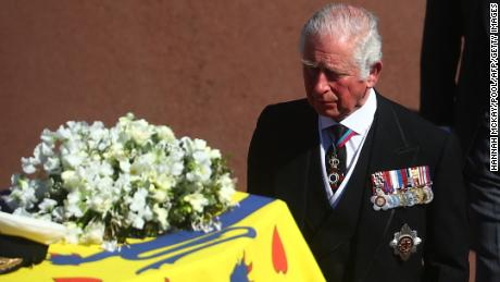 Britain's Prince Charles, Prince of Wales walks behind the coffin of Britain's Prince Philip, Duke of Edinburgh during a ceremonial funeral procession to St George's Chapel in Windsor Castle in Windsor, west of London, on April 17, 2021. - Philip, who was married to Queen Elizabeth II for 73 years, died on April 9 aged 99 just weeks after a month-long stay in hospital for treatment to a heart condition and an infection. (Photo by HANNAH MCKAY / POOL / AFP) (Photo by HANNAH MCKAY/POOL/AFP via Getty Images)