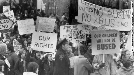 An anti-busing group holds a protest across from the Massachusetts State House in Boston on April 3, 1973.