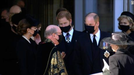Prince William and his brother Prince Harry walk together after Prince Philip's funeral.