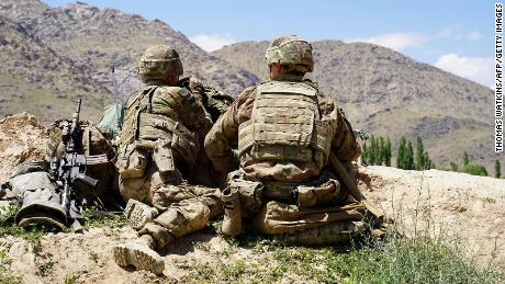 US soldiers look out over hills during a visit of the commander of US and NATO forces in Afghanistan, General Scott Miller, in Wardak province on June 6, 2019.
