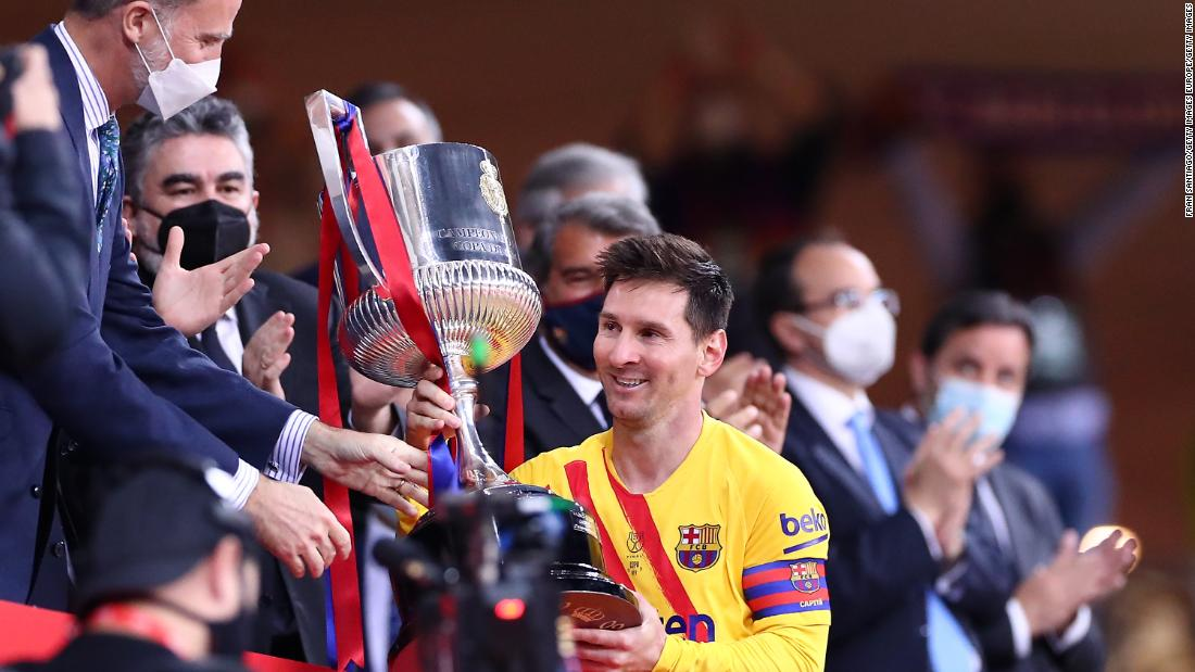 Is this goodbye? Barcelona teammates line up for photos with Lionel Messi following Copa del Rey victory