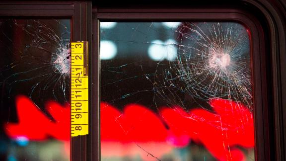 EDITORS NOTE: Graphic content / Damaged glass and adhesive measuring tape is pictured on a bus window at the scene of a shooting that left one person dead and seven injured, including a child, in downtown Seattle, Washington on January 22, 2020. - At least one person was killed and seven others, including a child, were wounded on Wednesday after gunfire broke out in downtown Seattle near a popular tourist area, police and hospital officials said. Police said at least one suspect was being sought in connection with the mass shooting that took place near a McDonald's fast food restaurant, just blocks away from the Pike Place Market. (Photo by Jason Redmond / AFP) (Photo by JASON REDMOND/AFP via Getty Images)
