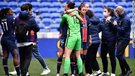 Christiane Endler is congratulated by her teammates at the final whistle.