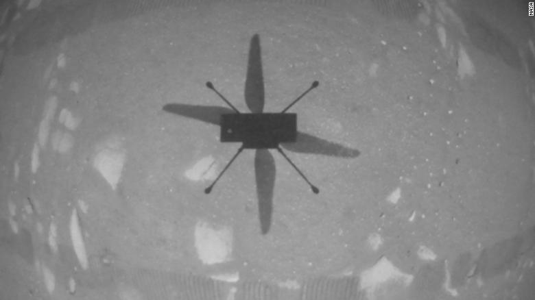 The helicopter's navigation camera captured a view of the Ingenuity's shadow on the Martian surface during its first flight.