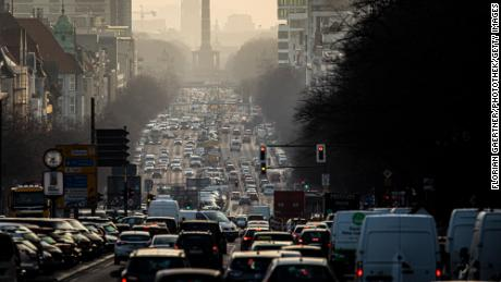 The morning rush hour on the street Bismarckstrasse is pictured during morning light on February 25, 2021 in Berlin, Germany. (Photo by Florian Gaertner/Photothek via Getty Images)