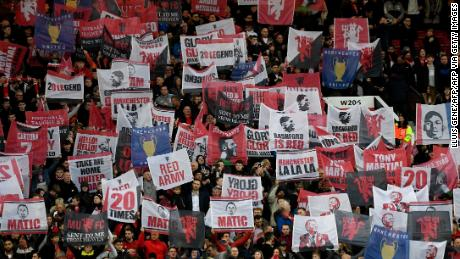 Manchester United fans hold up banners during their side's Champions League quarterfinal against Barcelona in 2019.