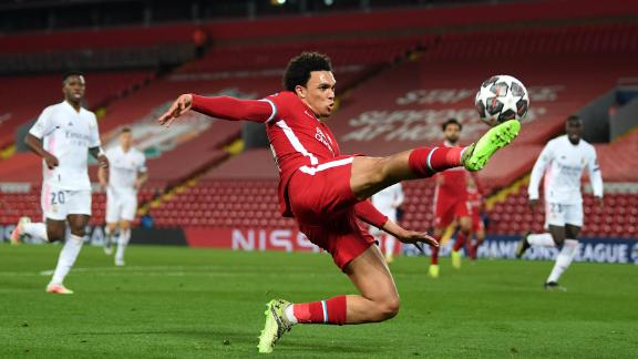 LIVERPOOL, ENGLAND - APRIL 14:  Trent Alexander-Arnold of Liverpool controls the ball during the UEFA Champions League Quarter Final Second Leg match between Liverpool FC and Real Madrid at Anfield on April 14, 2021 in Liverpool, England. Sporting stadiums around the UK remain under strict restrictions due to the Coronavirus Pandemic as Government social distancing laws prohibit fans inside venues resulting in games being played behind closed doors.  (Photo by Shaun Botterill/Getty Images)