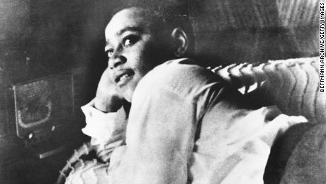 Emmett Till, shown lying on his bed, was lynched during a visit to rural Mississippi in 1955.