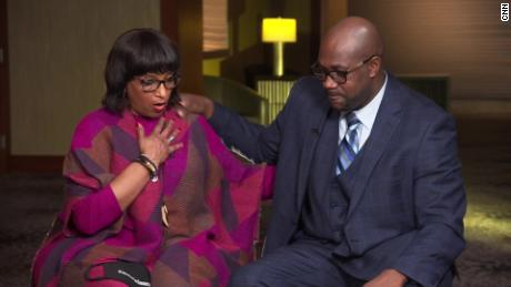 Deborah Watts and Philonise Floyd  try to comfort each other while talking about their grief.