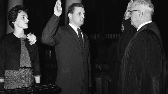 Mondale is sworn in as Minnesota Attorney General by Minnesota Supreme Court Chief Justice Roger Dell, right, on May 5, 1960, in St. Paul, Minnesota.