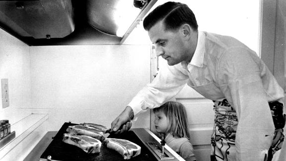 Mondale and his 4-year-old daughter Eleanor cook steaks in his family's new kitchen in Minneapolis on June 20, 1964.