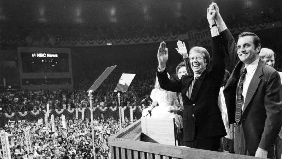 Jimmy Carter and Mondale clasp hands after their acceptance speeches for the Democratic presidential ticket at the Democratic National Convention at Madison Square Garden in Manhattan on July 15, 1976.