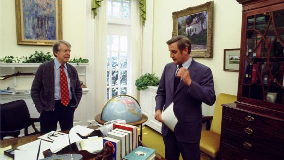 President Carter speaks with Vice President Mondale in the Oval Office in Washington, DC, in May 1977. They defeated the Republican ticket, Gerald Ford and Bob Dole, in the 1976 election.