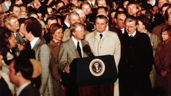 Mondale stands beside President Carter as he gives his concession speech on November 4, 1980, after losing to Ronald Reagan.