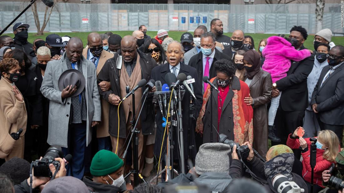 The Rev. Al Sharpton leads a prayer alongside Floyd's family members and politicians outside the Hennepin County Government Center in Minneapolis on Monday, April 19.
