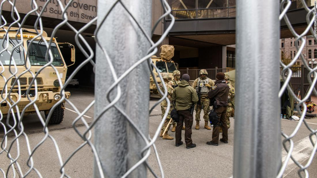 Law enforcement and National Guard members stage outside the courthouse in Minneapolis on April 19.