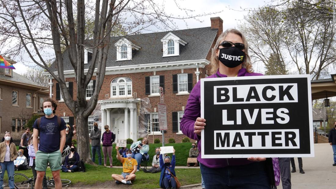 Demonstrators gather outside the home of Minnesota Gov. Tim Walz in St. Paul, for a rally and march against police brutality on April 18.
