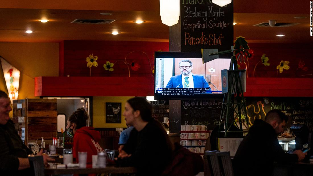 A television inside a Minneapolis restaurant shows the trial on April 1.