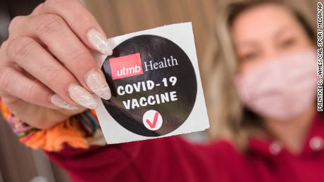 A patient displays a sticker proclaiming her recent Covid-19 vaccination in Lake Jackson, Texas, March 28. Think twice before announcing your vaccine status to friends and family and on social media platforms.