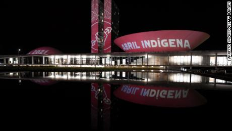 "Members of the Articulation of Indigenous Peoples of Brazil (APIB), project the phrase ""Indigenous April"" at the National Congress in Brasilia during Indigenous Day, on April 19, 2021."