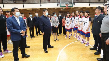 "Xi talks to basketball players at Tsinghua University, where he called on the school to cultivate students who are both ""red and professional."""
