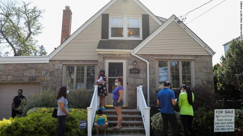 People wait to visit a house for sale in Floral Park, New York, on Sept. 6, 2020.