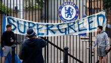 Chelsea fans put up a banner outside Stamford Bridge protesting the Super League.