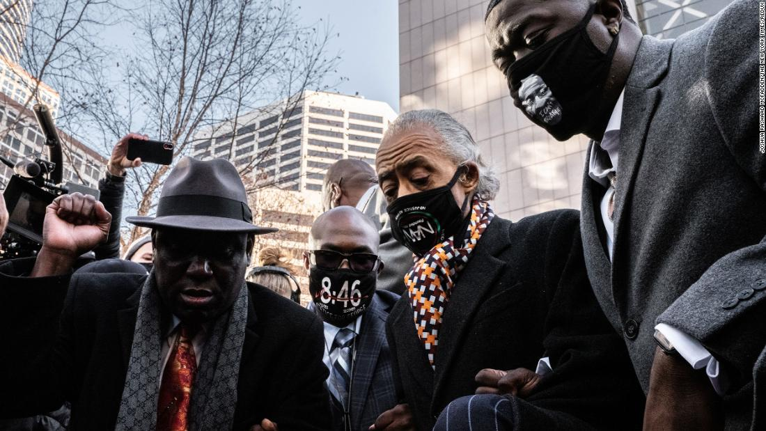 Attorney Ben Crump raises a fist as he takes a knee in Minneapolis with George Floyd's brother, Philonise, the Rev. Al Sharpton and Floyd's nephew, Brandon Williams, on March 29.