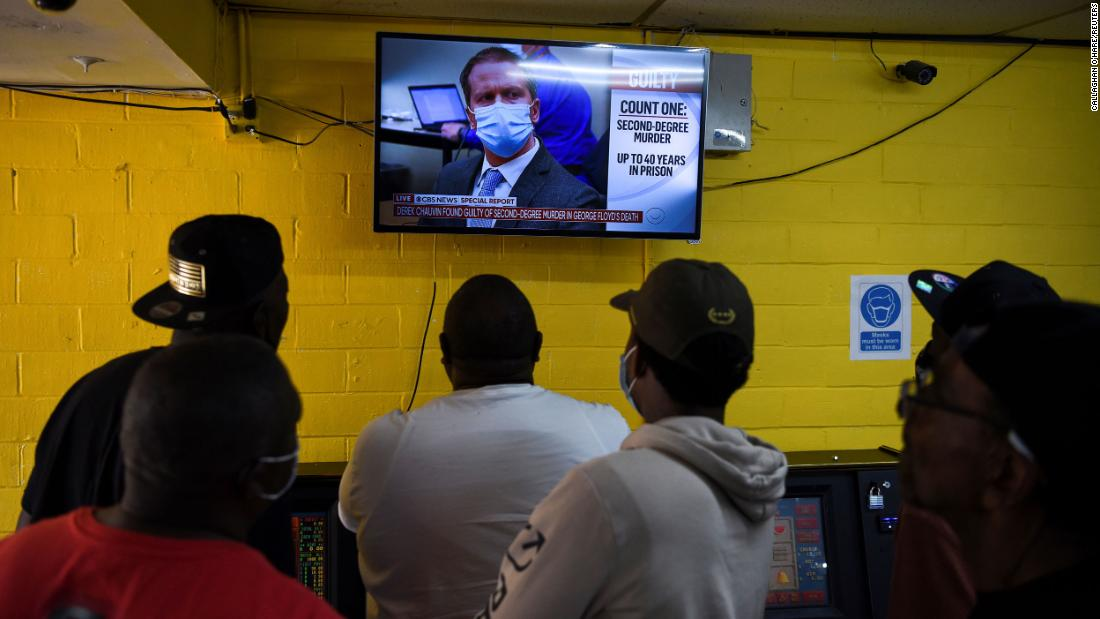 People in Houston's Third Ward watch the verdict announcement.