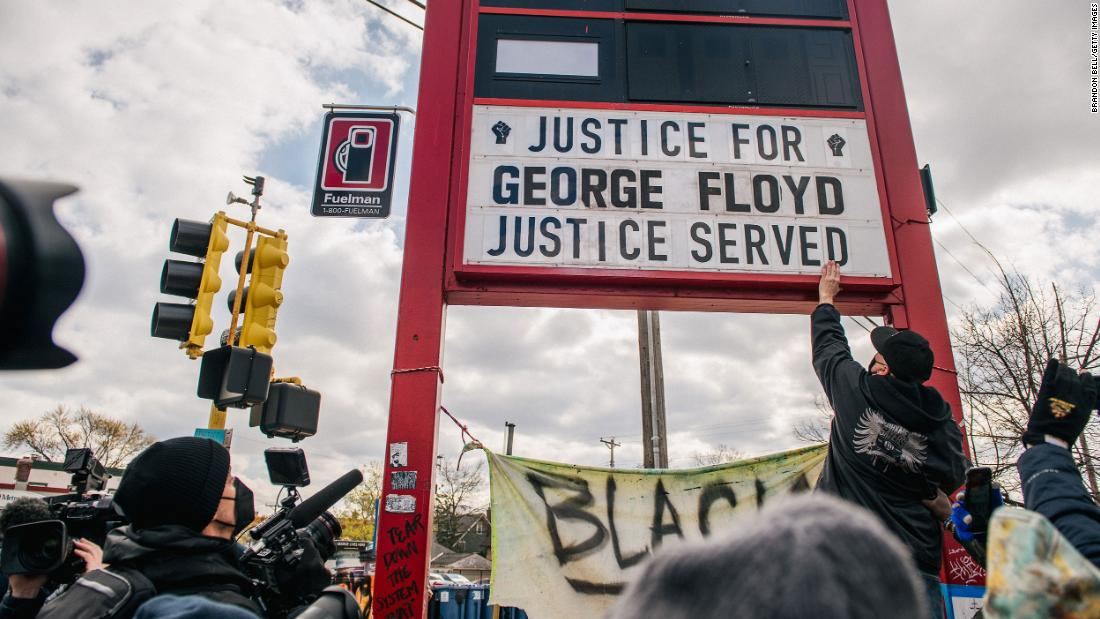 People in Minneapolis celebrate the guilty verdict at the intersection of 38th Street & Chicago Avenue -- the site where George Floyd died in May 2020.