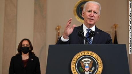Vice President Kamala Harris (L) listens as US President Joe Biden delivers remarks on the guilty verdict against former policeman Derek Chauvin at the White House in Washington, DC, on April 20, 2021. - Derek Chauvin, a white former Minneapolis police officer, was convicted on April 20 of murdering African-American George Floyd after a racially charged trial that was seen as a pivotal test of police accountability in the United States. (Photo by Brendan SMIALOWSKI / AFP) (Photo by BRENDAN SMIALOWSKI/AFP via Getty Images)