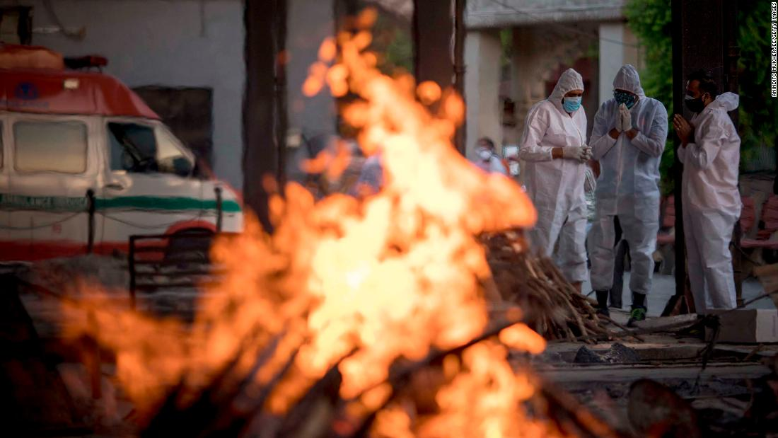 "Relatives of a patient who died from Covid-19 perform his last rites amid other burning pyres at a crematorium in New Delhi on April 17. A second wave of Covid-19 <a href=""http://www.cnn.com/2021/04/26/india/gallery/india-coronavirus-crisis/index.html"" target=""_blank"">is devastating India,</a> killing thousands of people each day and setting world records for daily infections."