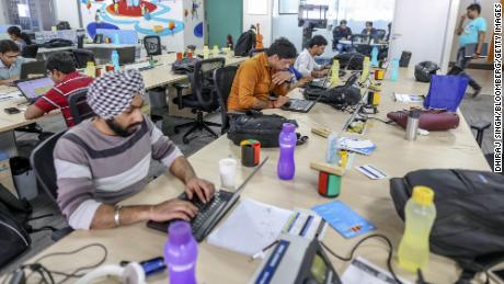 Employees work on laptop computers at the Flipkart  headquarters in Bengaluru, India.