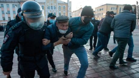 Police officers detain a protester in Ulan-Ude.